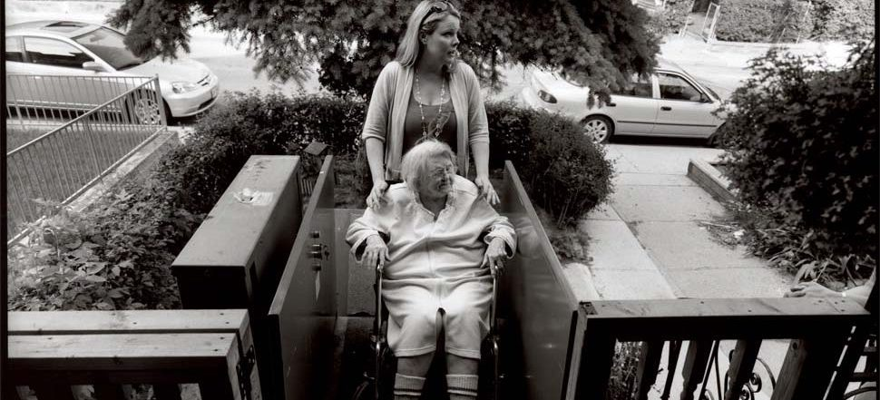 patient with caregiver on porch elevator